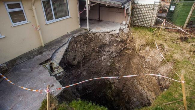Massive sinkhole opens up in UK backyard that could be ...