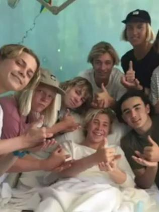 Shark attack victim Cooper Allen with his friends in hospital. Source: Nine News Sydney