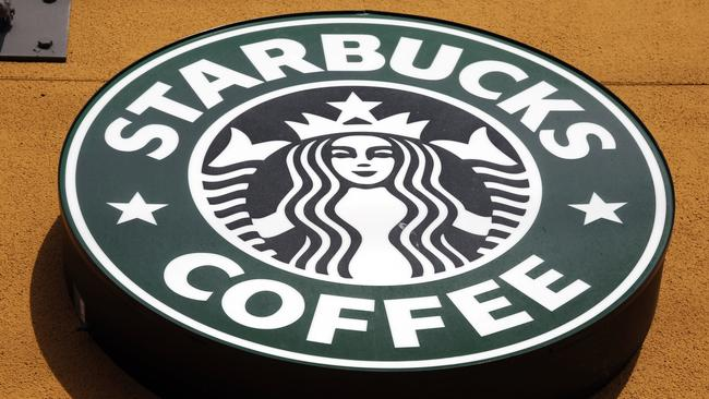 """FILE - This Jan. 3, 2012 file photo shows the Starbucks Coffee logo in Mountain View, Calif. The European Union's executive wants thousands of multinationals to disclose in what member states they make money and pay taxes, an effort to close loopholes and crack down on the use of tax havens. EU Taxation Commissioner Jonathan Hill said on Tuesday, April 12, 2016 he wanted """"to make sure that taxes are paid where profits are generated."""" Professor Crawford Spence of Warwick Business School said it was """"a small, but important step towards ensuring that multinational companies pay their fair share of tax"""" and lauded the public part of the proposal. """"Without transparency it would be impossible to shame companies into paying more. Of course, these sort of initiatives have a bigger impact on consumer facing organizations whose brand everybody recognizes, such as Google and Starbucks,"""" Spence said. (AP Photo/Paul Sakuma, File)"""
