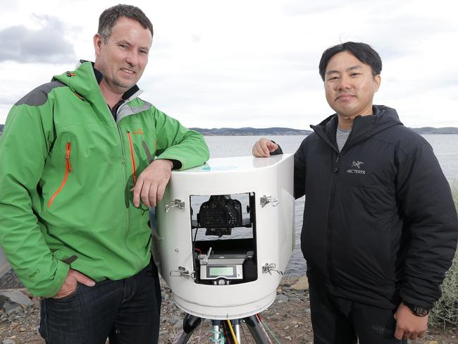 Tasmanian Dr Tim Lynch and his Korean counterpart Dr Jin Woo Jung. Picture: LUKE BOWDEN