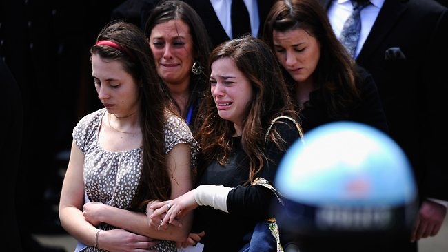MEDFORD, MA - APRIL 22: Mourners walk out of St. Joseph Catholic Church after the funeral service for Krystle Campbell, a victim of the Boston Marathon bombing, on April 22, 2013 in Medford, Massachusetts. A manhunt ended for Dzhokhar A. Tsarnaev, 19, a suspect in the Boston Marathon bombing after he was apprehended on a boat parked on a residential property in Watertown, Massachusetts. His brother Tamerlan Tsarnaev, 26, the other suspect, was shot and killed after a car chase and shootout with police. The bombing, on April 15 at the finish line of the marathon, killed three people and wounded at least 170. Kevork Djansezian/Getty Images/AFP== FOR NEWSPAPERS, INTERNET, TELCOS & TELEVISION USE ONLY ==