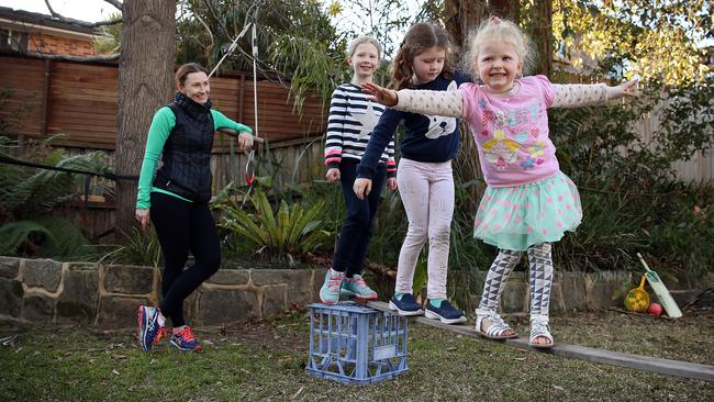 Stephanie Sheppard watches Rose (right), Annie (2nd from right) and Molly (second from left) tackle their backyard ninja warrior course. Picture: Sam Ruttyn