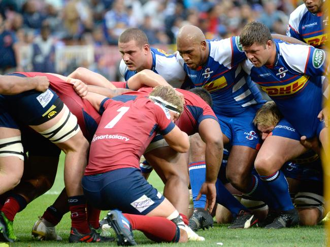 Reds and Stormers prepare to pack down a scrum.
