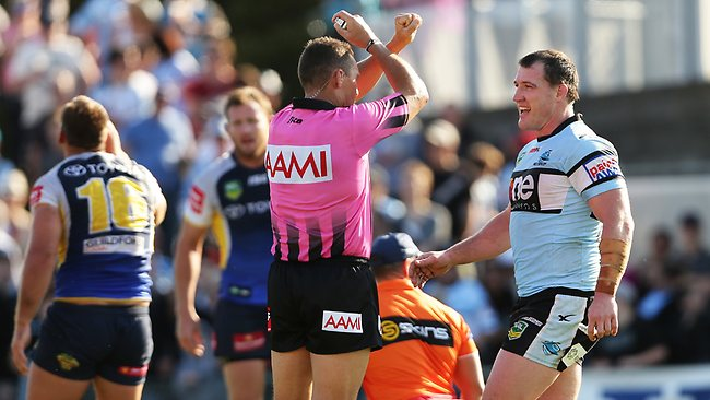 Referee Shayne Hayne puts Cronulla captain Paul Gallen on report for a 'crusher' tackle on North Queensland's Scott Bolton during the Sharks win on Sunday. Picture: Brett Costello