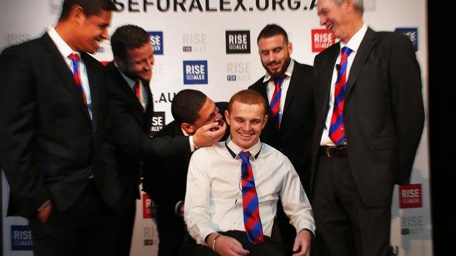 Newcastle Knights players support Alex McKinnon to launch Rise For Alex round. Pic: Phil Hillyard