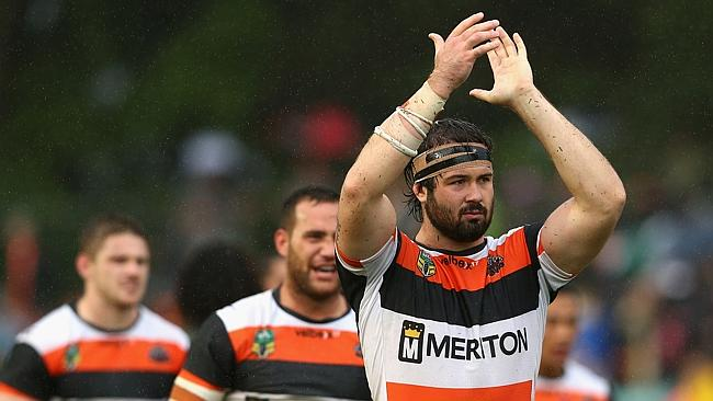 Aaron Woods of the Tigers and team mates thank fans.