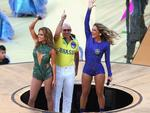 (L-R) Singers Jennifer Lopez, Pitbull and Claudia Leitte perform during the Opening Ceremony of the 2014 FIFA World Cup Brazil prior to the Group A match between Brazil and Croatia at Arena de Sao Paulo on June 12, 2014 in Sao Paulo, Brazil. (Photo by Elsa/Getty Images)