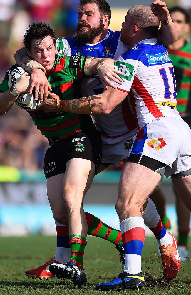 Luke Keary is tackled by Beau Scott and Adam Cuthbertson.