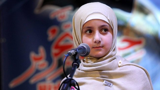 Eight-year-old Ruqaya speaks at the Khilafah Conference in Bankstown, Sydney. Picture: James Croucher
