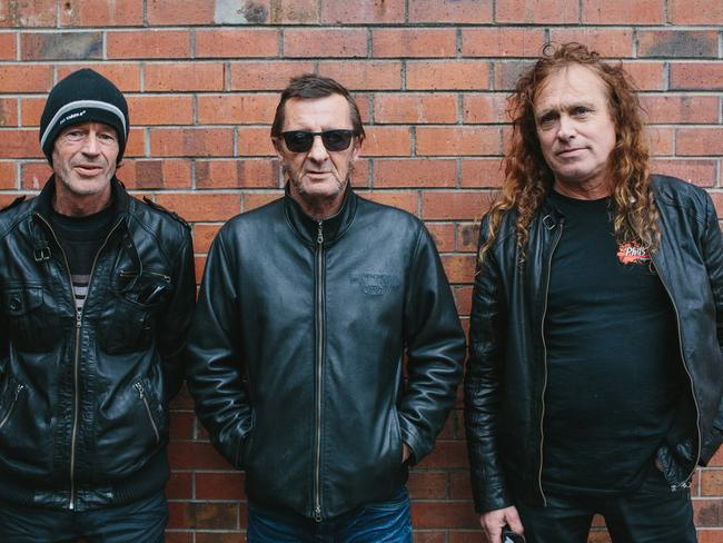 Estranged: Rudd (centre) with his group The Phil Rudd Band