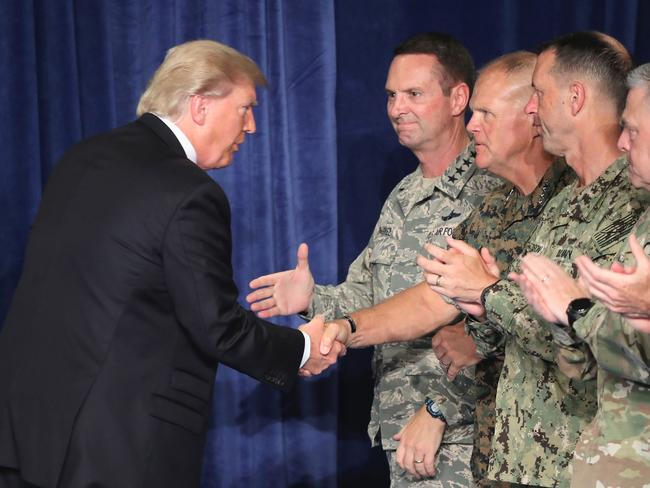 Mr Trump greets military leaders before his speech on Afghanistan. Picture: Mark Wilson/Getty Images/AFP