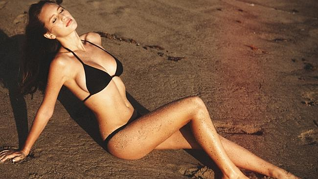 Dylan Penn looks hot on the beach in GQ magazine.