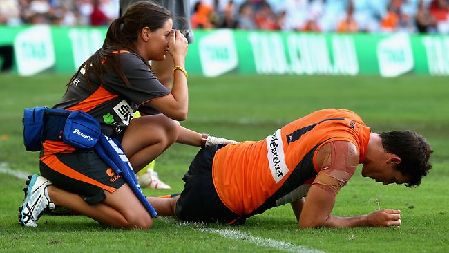 SYDNEY, AUSTRALIA - MARCH 30: Phil Davis of the Giants lies on the ground after injuring his hip during the round one AFL match between the Greater Western Sydney Giants and the Sydney Swans at ANZ Stadium on March 30, 2013 in Sydney, Australia. (Photo by Ryan Pierse/Getty Images)