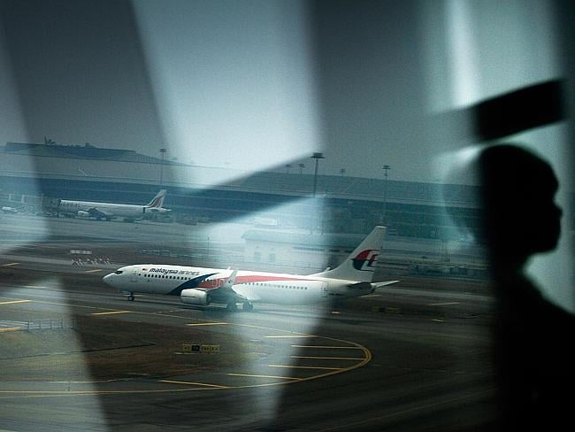 A Malaysia Airlines plane is seen on the tarmac at Kuala Lumpur International Airport on