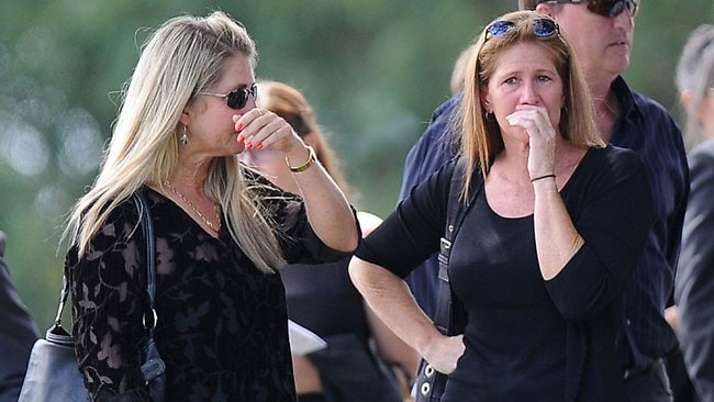 "Relatives and friends of the late South African model Reeva Steenkamp mourn for the funeral ceremony at the crematorium building in Port Elizabeth on February 19, 2013 after Steenkamp, 29, was shot four times in the early hours of February 14, 2013 by a 9mm pistol owned by South African sporting hero Oscar Pistorius. South African prosecutors on Tuesday told a bail hearing that Oscar Pistorius was guilty of ""premeditated murder"" in the Valentine's Day killing of his model girlfriend at his upscale home. AFP PHOTO / ALEXANDER JOE"