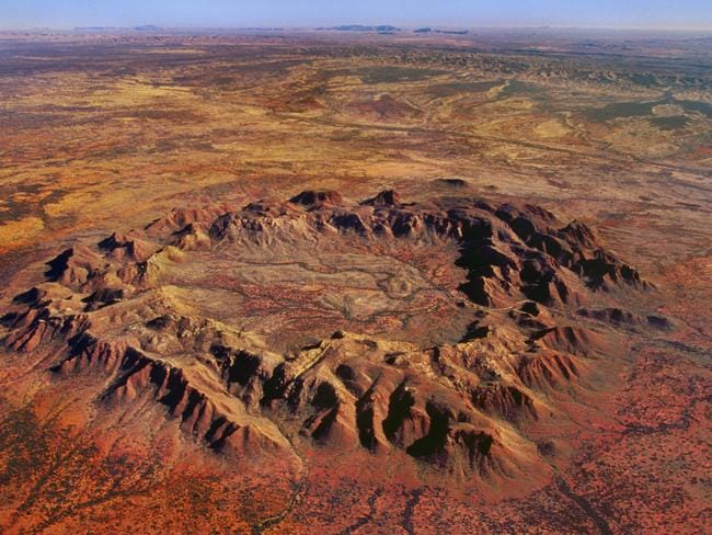 Thought to be the result of an asteroid impact in the heart of Australia, just west of Alice Springs, the edges of this crater have been eroded over time. Picture: Supplied