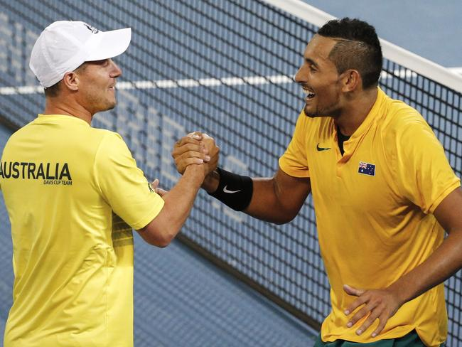 Hewitt congratulates Kyrgios after the win.