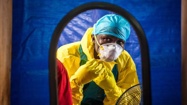 Protection ... a healthcare worker dons protective gear before entering an Ebola treatment centre in Sierra Leone. Picture: AP Photo/Michael Duff
