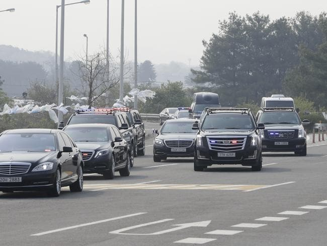 A motorcade carrying South Korean President Moon Jae-in arrives at the Unification Bridge, which leads to the Panmunjom in the Demilitarised Zone, in Paju. Picture: Lee Jin-man/AP