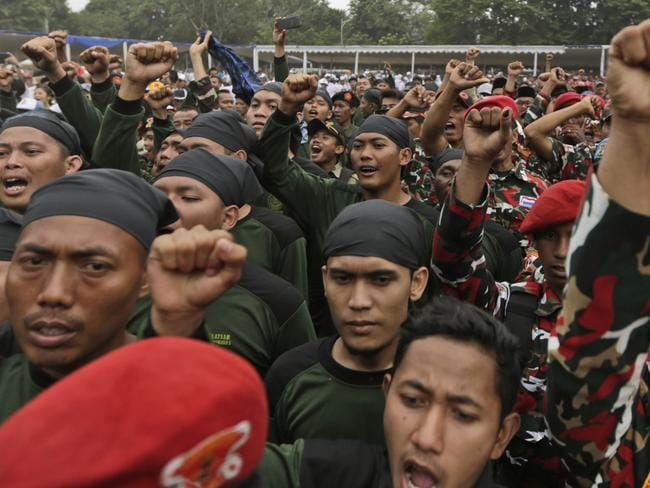 Hundreds rally ... Indonesian men chant slogans during an interfaith rally against radicalism, terrorism and drug abuse in Jakarta. Picture: AP