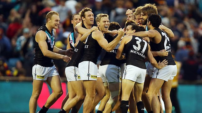 Power players celebrate after the round 19 AFL match between the Adelaide Crows and Port Adelaide Power at AAMI Stadium.