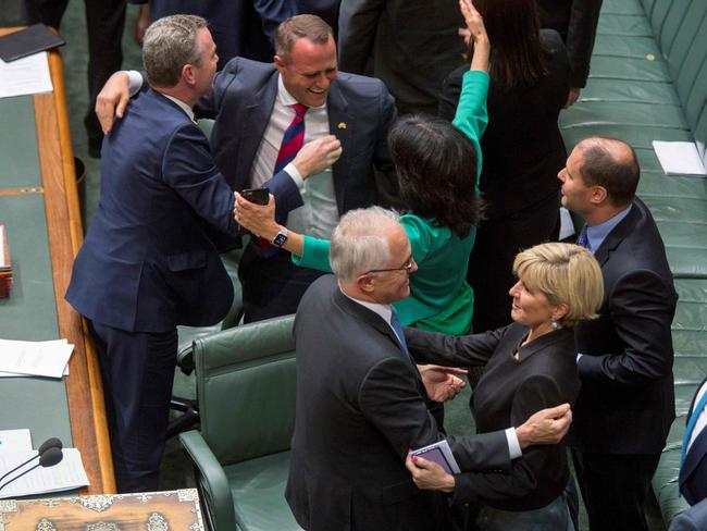 Coalition MPs pat themselves on the back after Thursday's vote. Picture: AFP/Sean Davey