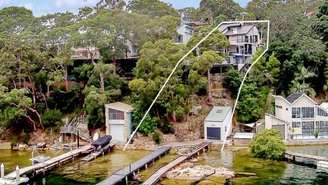 The home backs onto the water and has its own boatshed and separate jetty and pontoon.