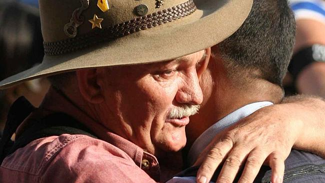 Spike Stewart whose son Anthony was killed in Bali hugs an Indonesian leader at a commemoration service in 2006. Picture: Lukman S. Bintoro.