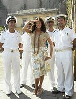 <p>Model Megan Gale with sailors at the launch of David Jones summer collections in Sydney. 2005.</p>