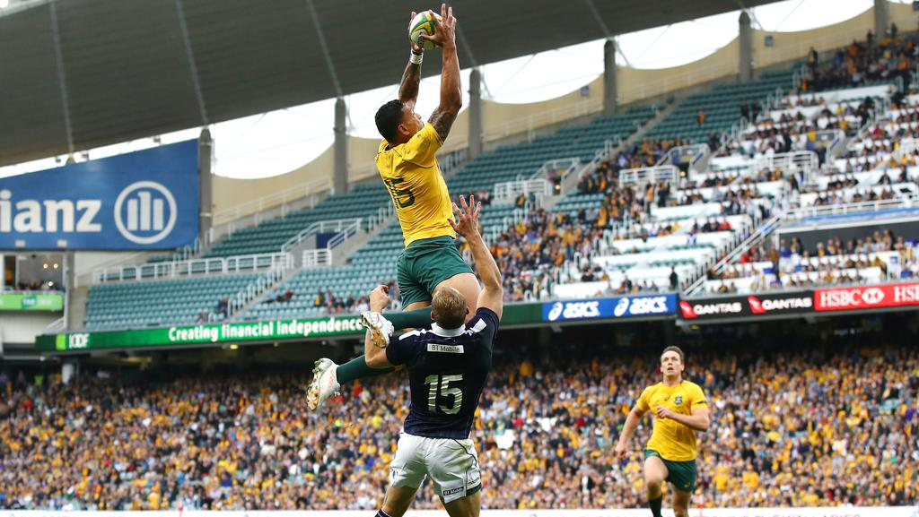 Israel Folau scores a spectacular try against Scotland.