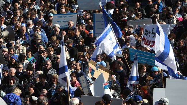 Protesters carry Israel flags at the rally. Picture: Brendan Francis