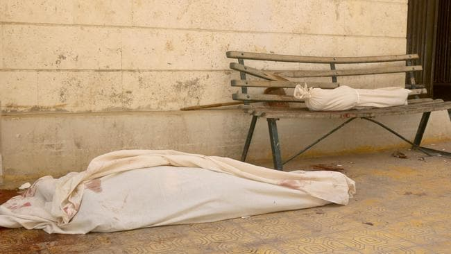 Two bodies wrapped in cloth are laid out in front of a makeshift hospital in the Tariq al-Bab neighbourhood of Aleppo, following air raids that targeted rebel-held areas in the northern city. Picture: AFP/THAER MOHAMMED