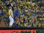 (From L-R) US rapper Pitbull, Brazilian pop singer Claudia Leiite and US singer Jennifer Lopez perform during the opening ceremony of the 2014 FIFA football World Cup at the Corinthians Arena in Sao Paulo on June 12, 2014. AFP PHOTO / ODD ANDERSEN