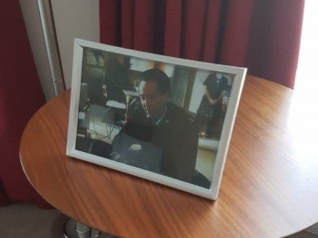 The hotel framed an picture of Christopher Walken in Pulp Fiction. Picture: Facebook/Daniel Buckley around Storyful