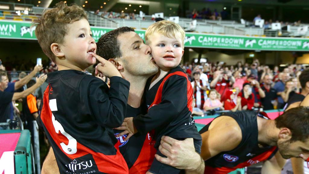Brent Stanton enters the field with his sons Connor and Aiden ahead of his 250th game for Essendon. Picture: Darren England.