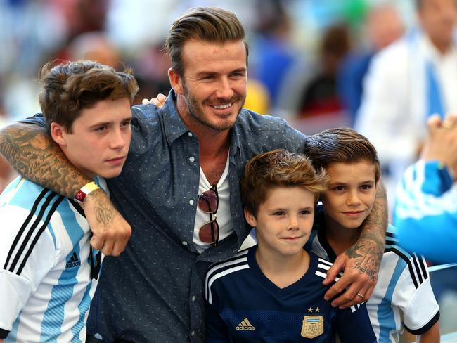 Beckham boys ... Former England international David Beckham and sons Brooklyn Beckham (L), Cruz Beckham (2nd R) and Romeo Beckham (R) prior to the 2014 FIFA World Cup.