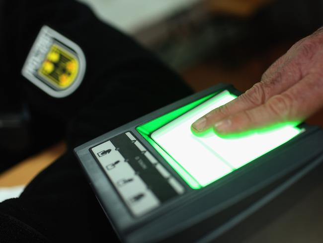 A migrant gives his finger print at a processing centre. Picture: Getty