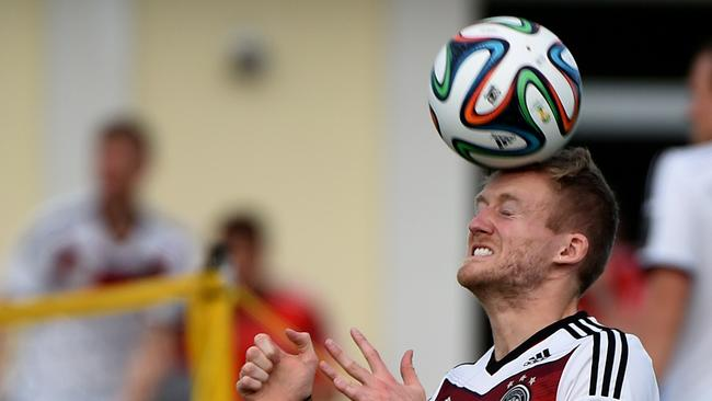 Germany's forward Andre Schuerrle heads the ball as he warms up during a training session in Santo Andre on Friday.
