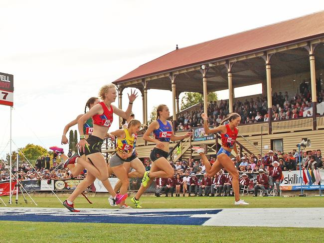 Liv Ryan (nearest) wins the 120m women's foot race at the famous Central Park at Stawell. Picture: Getty Images