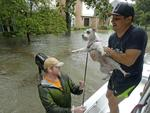 Volunteers evacuate people and pets from a neighborhood inundated by floodwaters from Tropical Storm Harvey on Monday, Aug. 28, 2017, in Houston, Texas. Picture: AP Photo/Charlie Riedel