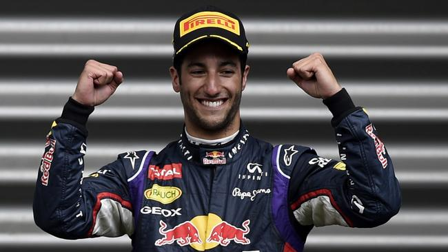 Daniel Ricciardo celebrates on the podium at the Spa-Francorchamps circuit after winning the Belgian GP.