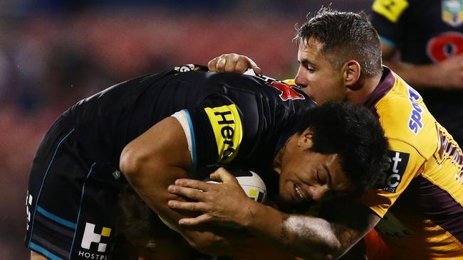 Sika Manu of the Panthers is tackled.