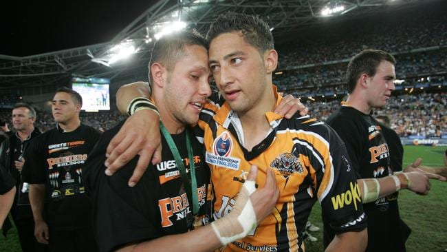Scott Prince and Benji Marshall celebrate their grand final win.