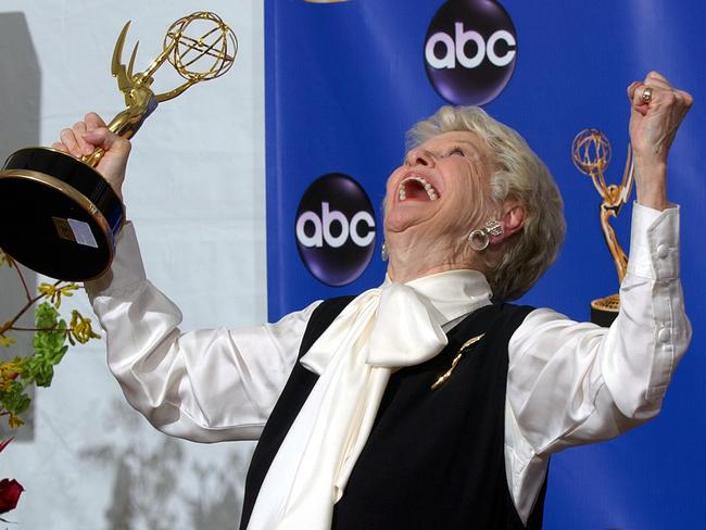 Stritch celebrating with her trophy for outstanding individual performance in a variety or music program at the 56th Annual Primetime Emmy Awards in 2004. Picture: AP Photo