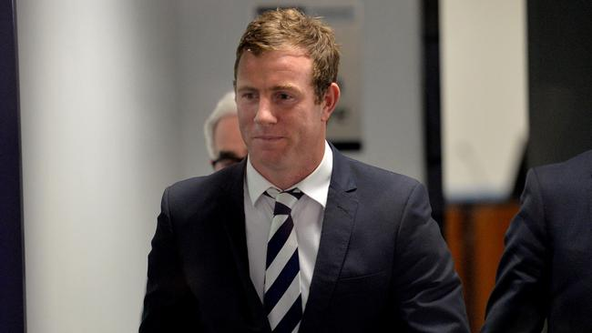 Johnson was all smiles leaving the AFL tribunal. Picture: Mike Keating