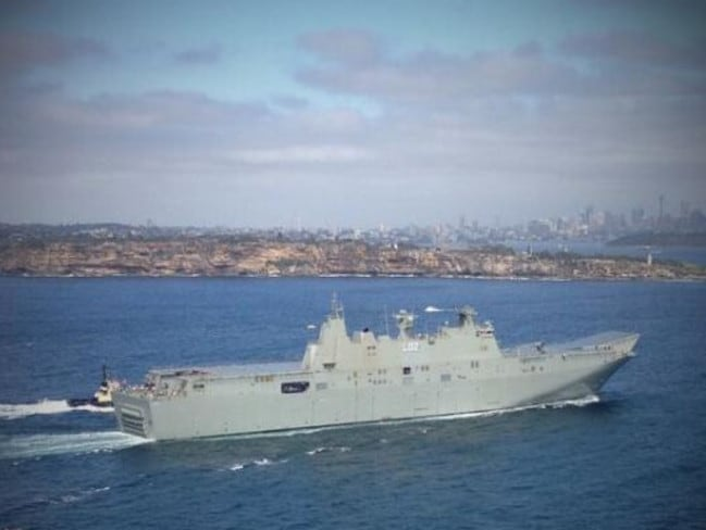 Budget buy ... HMAS Canberra heads to sea for testing. The Australian versions of this type of vessel have not been constructed to the necessary standards, or fitted with equipment, to operate jet fighters. Picture: Twitter