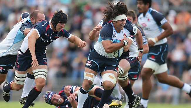 AJ Gilbert of the Waratahs is tackled during the Super Rugby trial match between the Waratahs and the Rebels at North Hobart Stadium.