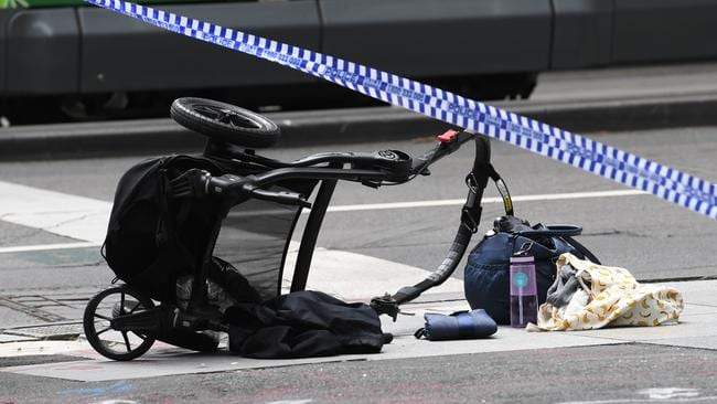 A pram is seen on the corner of Bourke and William Street after a man went on a rampage in a car through Bourke St mall, Melbourne, Friday, Jan. 20, 2017. Picture: AAP /Julian Smith.