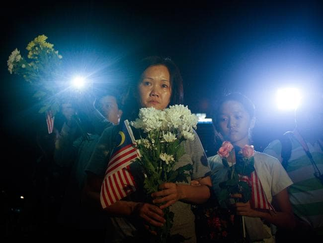 Family of the crew members of MH17 pay their respect during a vigil on July 22, 2014 in Kuala Lumpur, Malaysia. Picture: Getty