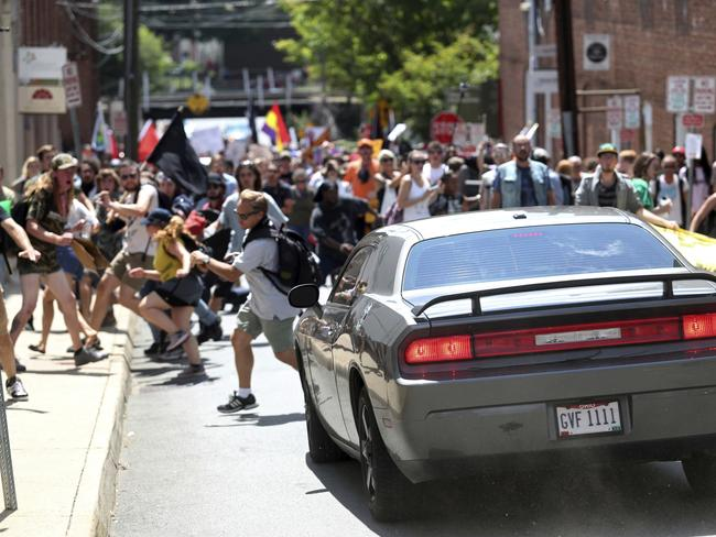 A vehicle drives into a group of protesters demonstrating against a white nationalist rally in Charlottesville. Picture: AP